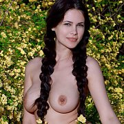 Braided Raven Tails On Busty Babe Outdoors