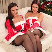 Brunette Babe In Santa Helper Uniforms And Stockings