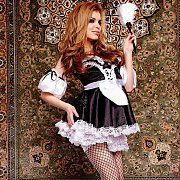 Redheaded Babe In Fishnets And Maids Uniform