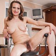 Naked Brunette Milf Hairy Below On Bar Stool