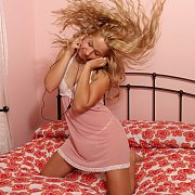 Latina Teen In Lingerie Listening To Music