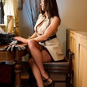 Arousing Stockings Legs Milf At The Typewriter