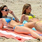 Couple Of Tasty Bikini Teens Laying Out At Beach