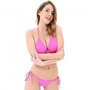 Brunette Babe Sybil Posing In A Pink Bikini