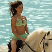 Caterina Murino Riding A Horse In Her Bikini