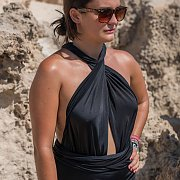 Lady Posing In A Black Wrap Swimsuit Outdoors