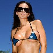 Hot Raven Babe In A Micro Bikini