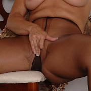 Milf Rubbing Her Pantyhose Pussy On A Chair