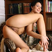 Short Raven Hair Nude In A Home Library