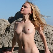 Pretty Nude Erotic Teen On The Rocks