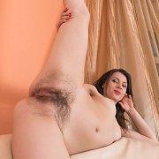 Brunette Woman Hairy Below Holding A Leg Up