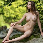Fantastic Nude Erotica Model On A Boulder In Nature