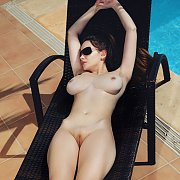 Busty Nude Model Laying Out In Sunglasses