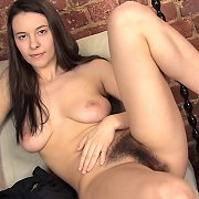 Naked Brunette Gal With A Hairy Pussy