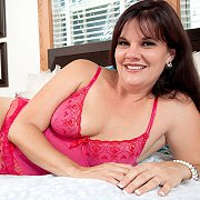 Laying On Her Side Lingerie Mature Smiling
