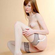 Pretty Stockings On An Erotic Redhead Model
