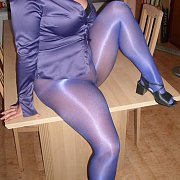 Playful Mom In Her Sparkly Nylons On The Table