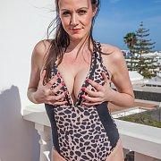 Swimsuit Milf Brunette Holding Her Tits