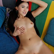 Nude Erotic Asian With Hair In Tails