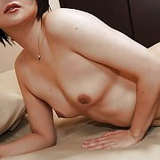 Nude Asian Milf Teases On The Bed