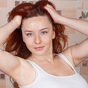 Tight White Top On A Freckled Redhead Lady