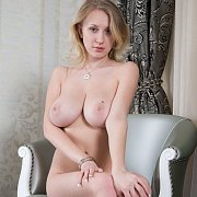 Wonderful Big Boobs Blonde Babe Sitting In A Chair