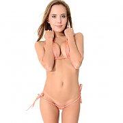 Brunette Babe Teasing In A Micro Bikini