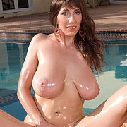 Lubed Up Busty Milf Spreading By Pool