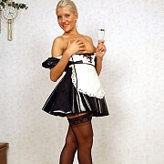 Blonde Maid In Stockings Starting To Strip