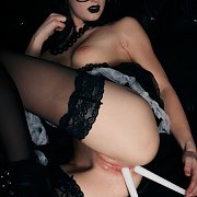 Goth Chick In Stockings Uses Candles