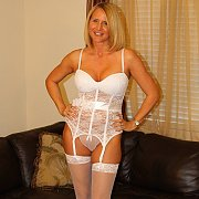 White Stockings And Lingerie On Sexy Milf