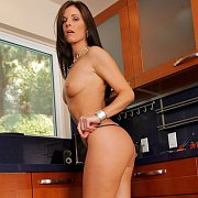 Hot Legs Heeled Cougar Posing In The Kitchen
