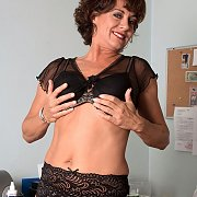 Teasing Older Woman In Her Garters