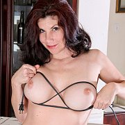 Playful Naked Mature Lady At The Ironing Board