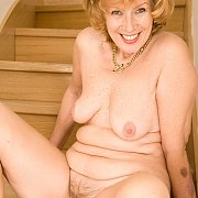 Smiling Redhead Older Lady On The Stairs