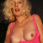 Lip Licking Mature Blonde With Breasts Hanging Out