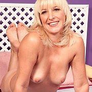 Teasing Blonde Older Lady On The Bed