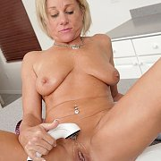 Naked Mature Blonde Waters Her Treasure Pot