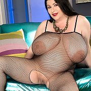 Large Raven Hair Lady In Fishnet Bodystocking