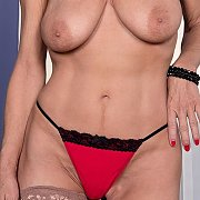 Beautiful Grandma Poses Topless In Red Panties