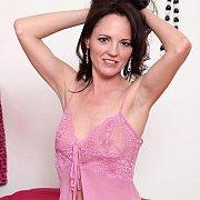 Mature Brunette In Pink Lingerie