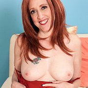 Older Redheaded Woman Showing Her Breasts