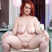 Nude Redhead BBW Sitting With Legs Open