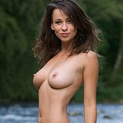 Stunning Brunette Naked Outdoors By A Rushing River