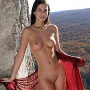 Beautiful Girl Getting Naked Outdoors Overlooking The Valley