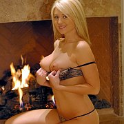 Lusty Teen Showing Her Big Tits By The Fireplace