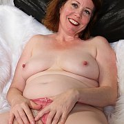 Mature Redhead With Pale Flesh Masturbates