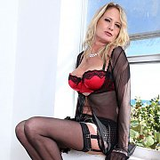 Blonde Mature Lady In Lingerie And Stockings