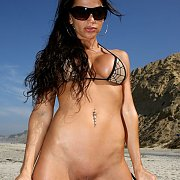 Dark Haired Beach Babe Flashing Smooth Pussy