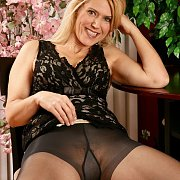 Smiling Blonde Milf Showing Her Nylons